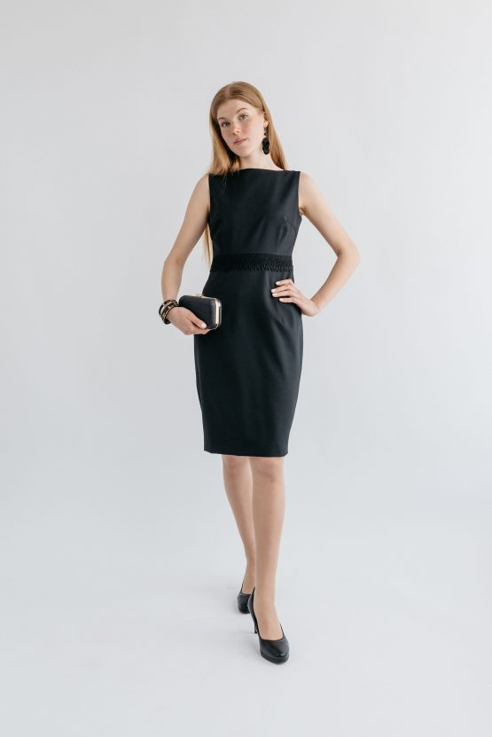 Woman wearing Coocos dsgn black dress